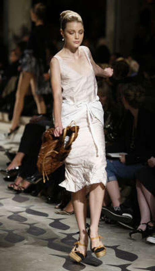 Falling out: The shoes for Prada's spring/summer 2009 collection gave models fits on the runway. Photo: LUCA BRUNO, Associated Press