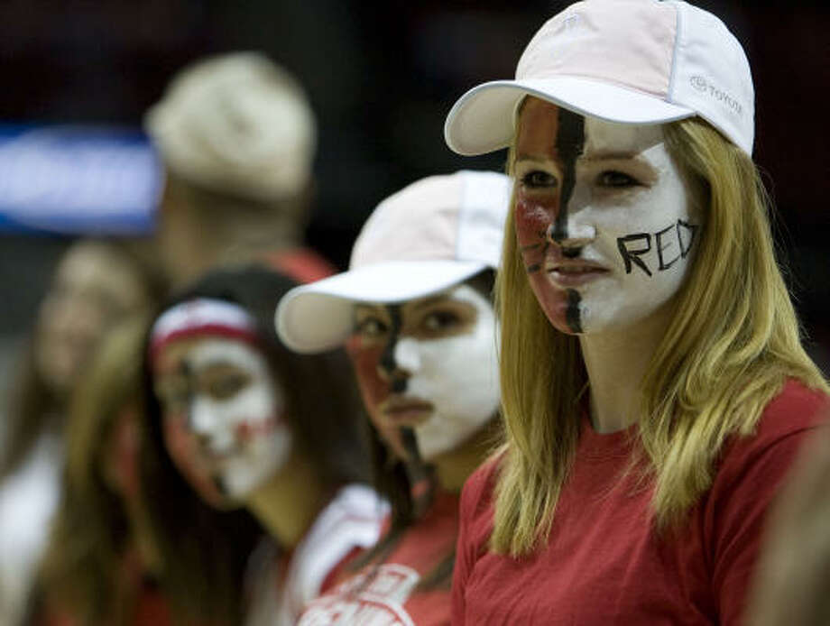 Amelia Gray (right) along with other students from El Campo High School wait on the court to greet the Houston Rockets before Wednesday's season opener against the Memphis Grizzlies at Toyota Center. Photo: James Nielsen, Chronicle