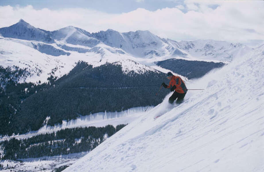A skier takes in the scenery as he glides down a high-alpine slope at Copper Mountain, west of Denver. Photo: Copper Mountain