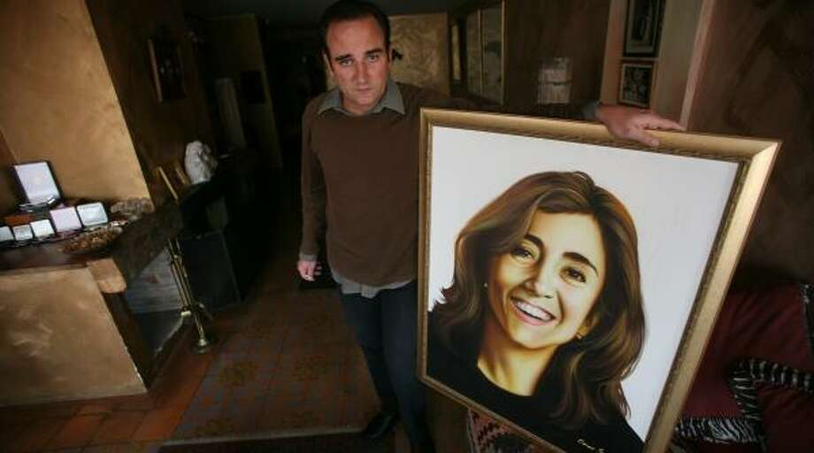 Juan Carlos Lecompte, husband of abducted former Colombia presidential contender Ingrid Betancourt, displays her portrait as he continues his dogged efforts to secure her freedom. Photo: SCOTT DALTON, FOR THE CHRONICLE