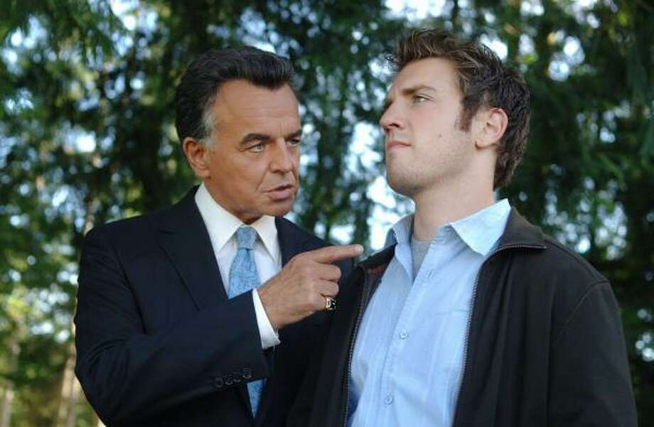 In Reaper, the devil (Ray Wise, left) recruits a young slacker, Sam Oliver (Bret Harrison), to round up any evil souls who have escaped the fiery pits. And how these escapees are tracked down is what fans the flames of comedy. Photo: SERGEI BACHLAKOV, THE CW