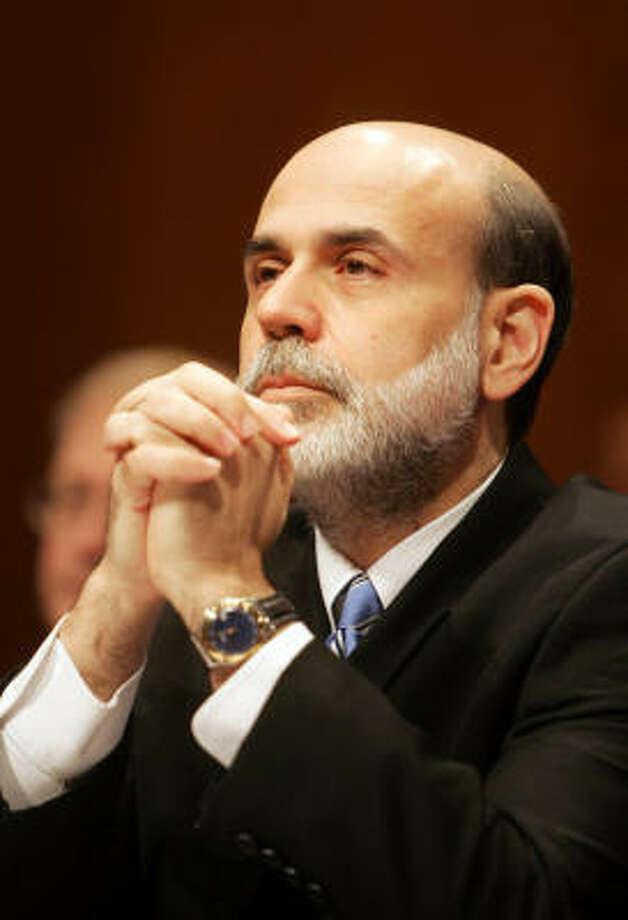 Ben Bernanke marks his first-year anniversary as Federal Reserve chief with healthy economic growth that seems to be generating less inflation. Photo: TIM SLOAN, AFP/Getty Images