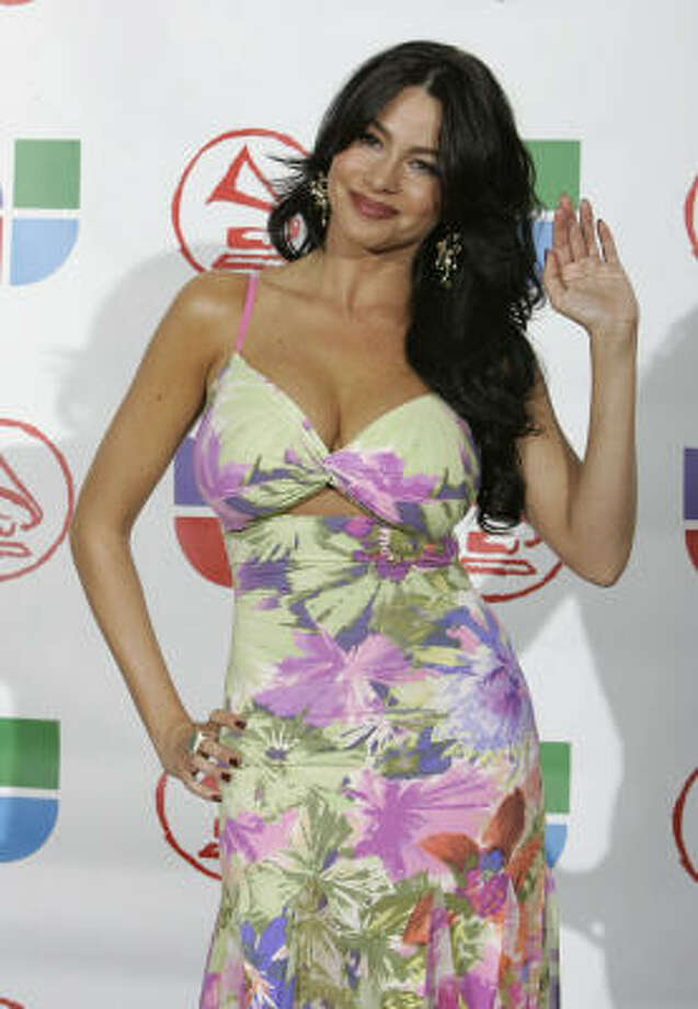 FLOWER POWER:Brunette (formerly blonde) bombshell Sofia Vergara has made a career out of never revealing too much skin while still showcasing her curvy figure. Photo: GERARD BURKHART, AFP/Getty Images