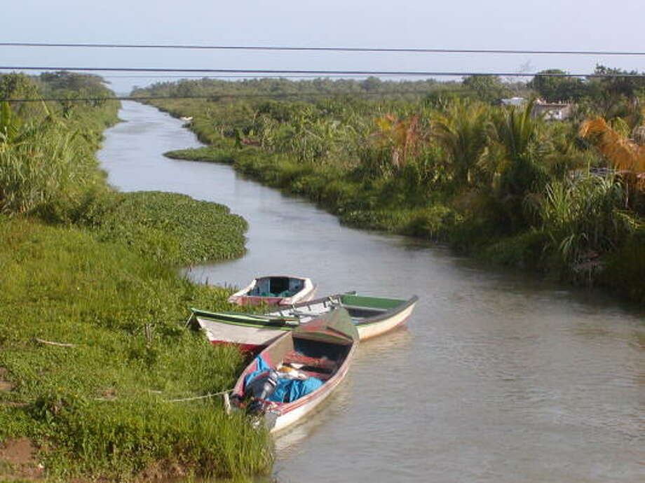 Boats park along an inlet near Negril, a beach resort in western Jamaica. Photo: AISSATOU SIDME, San Antonio Express-News