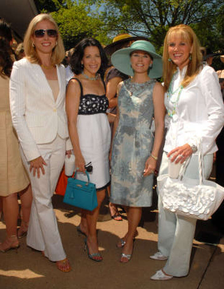 Martha Britton, from left, Anita Gaylor, Mindy Hildebrand and Marian Langston enjoy perfect weather at the River Oaks tennis tournament luncheon and Tootsies fashion show. Photo: Dave Rossman, For The Chronicle