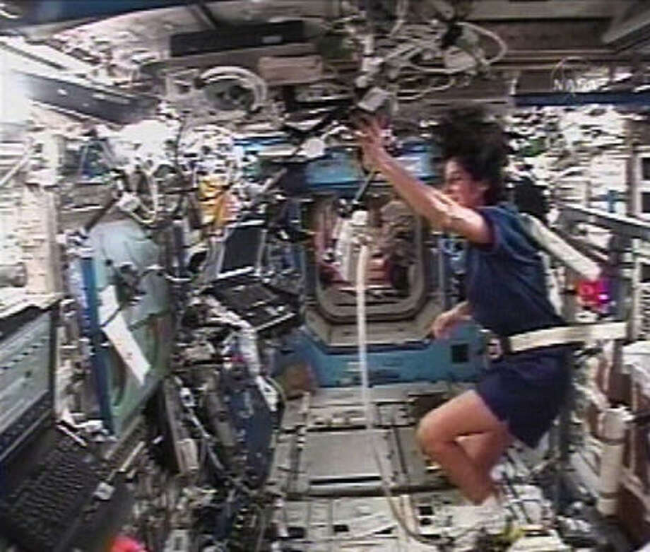 In this image from NASA Television, flight engineer Sunita Williams can be seen using an exercise device in the lab of the International Space Station, Feb. 22, 2007. Williams will attempt to run the Boston Marathon using the treadmill on board the station. Photo: AP
