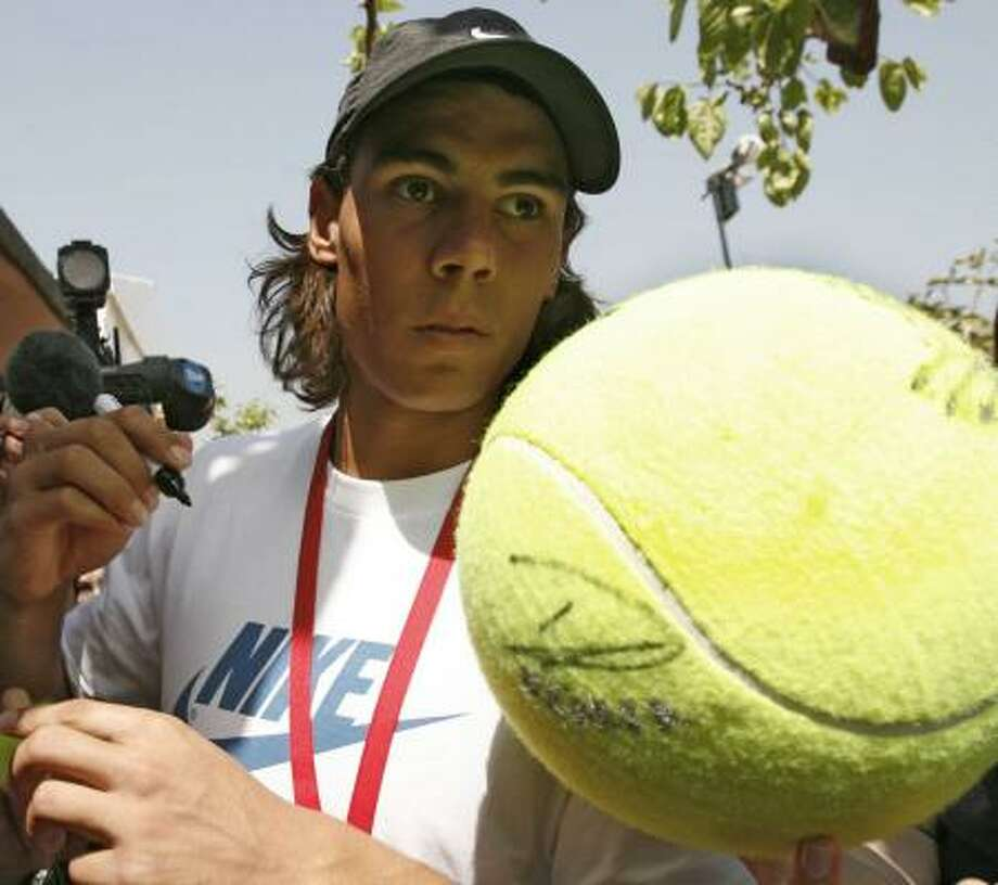 Even though he wasn't playing, Rafael Nadal was the center of attention Monday in Barcelona. Photo: GUIDO MANUILO, ASSOCIATED PRESS