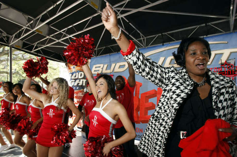City council member Wanda Adams cheers with the Houston Rockets Power Dancers during the Houston Rockets Get Red Rally outside Houston City Hall. Photo: Johnny Hanson, Chronicle