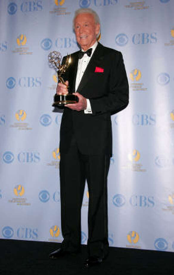 """Bob Barker poses with his Emmy for """"Outstanding Game Show Host"""" at the 59th Annual Daytime Emmy Awards in Hollywood. Photo: Frazer Harrison, Getty Images"""