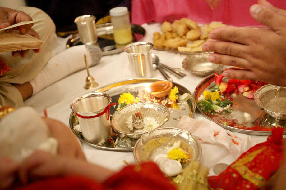 The Mehra family of Houston celebrates Diwali, the popular festival of lights celebrated by Hindus, Sikhs and Jains. The holiday is a joyful family time that marks the victory of good over evil and light over darkness. Photo: Bill Olive, For The Chronicle