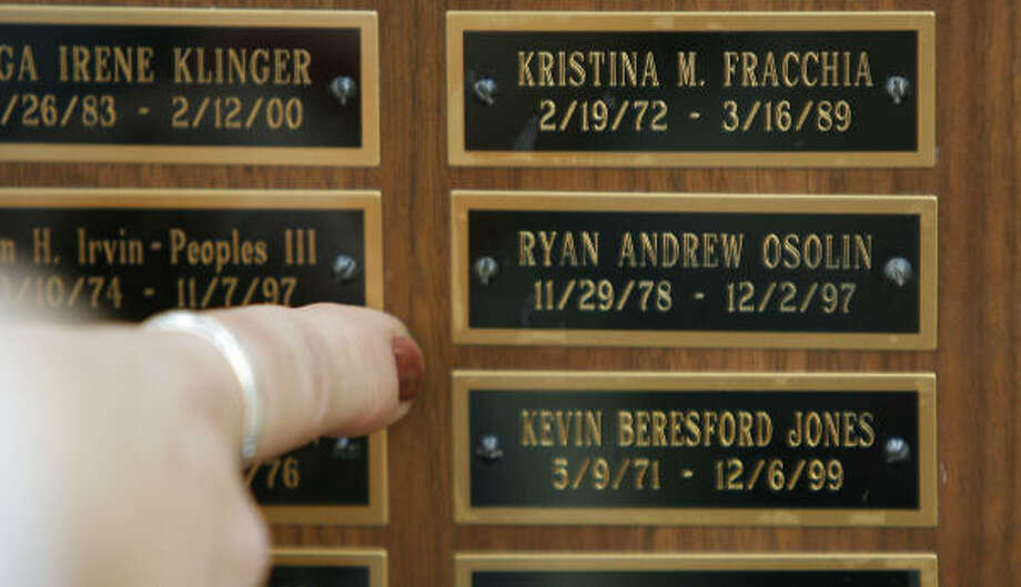"""Sue Osolin finds the name of her son, Ryan, on the plaque that is part of the """"Murder Wall"""". The National Organization of Parents of Murdered Children unveiled a """"Murder Wall"""" to honor the thousands of homicide victims in Houston. Photo: Steve Campbell, Chronicle"""