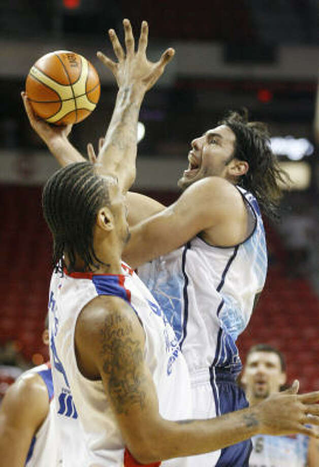 New Rocket Luis Scola, right, helped rally Argentina from an early 14-point deficit to a 87-75 win. Photo: Isaac Brekken, AP