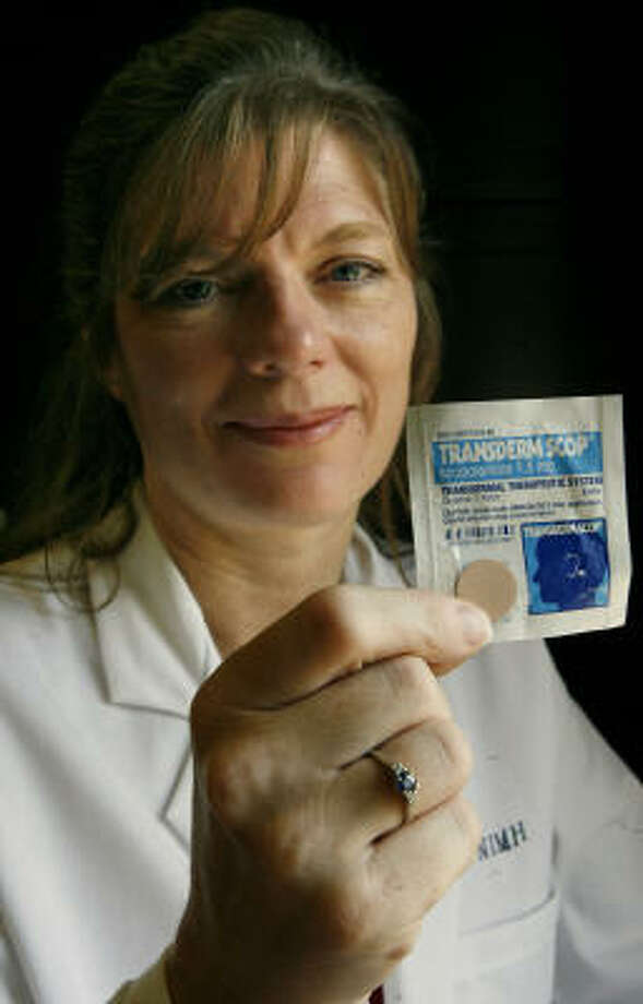 Dr. Maura Furey, a National Institute of Mental Health researcher, shows the scopolamine patch she and others have been testing to treat depression in bipolar disorder cases. Photo: Jacquelyn Martin, AP
