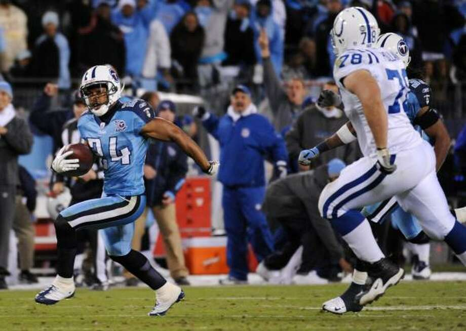 Titans 31, Colts 21 Tennessee Titans safety Chris Hope (24) runs back an interception 39 yards against Indianapolis Colts offensive lineman Mike Pollak (78). Photo: John Russell, AP