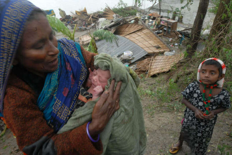 A grandmother in Barishal holds a newborn baby named Cyclone after the devastating storm. Photo: Pavel Rahman, Associated Press