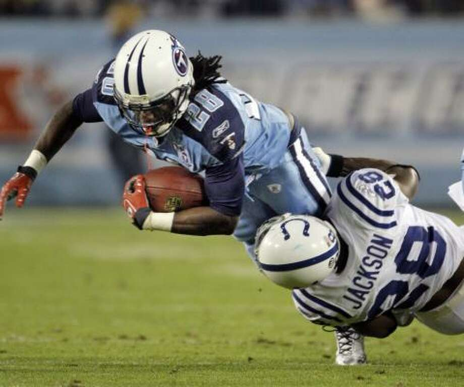 Tennessee Titans running back Chris Johnson (28) is brought down by Indianapolis Colts cornerback Marlin Jackson (28). Photo: Mark Humphrey, AP