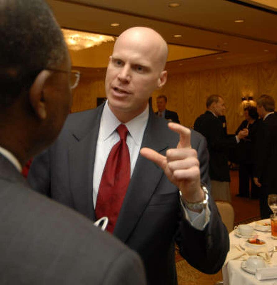 James Lambright, chairman of the Ex-Im Bank, talks with Sola Oyinlola, treasurer of Schlumberger. Photo: Tony Bullard, FOR THE CHRONICLE