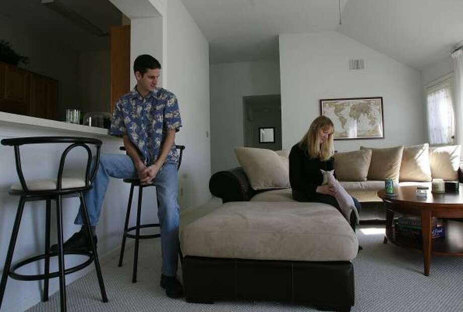 Daniel and Nicci Obert moved from Illinois to take jobs in Galveston, but high prices led them to buy a home in League City. Photo: JAMES NIELSEN, CHRONICLE