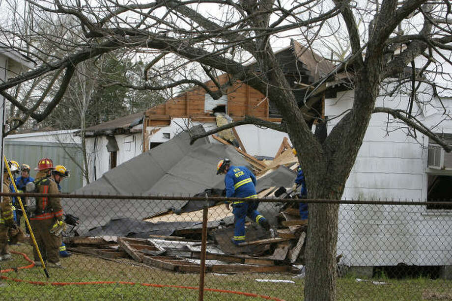 Fire crews look for victims Monday at the site of an empty church that collapsed in northeast Houston. No one was found. Photo: Steve Campbell, Chronicle