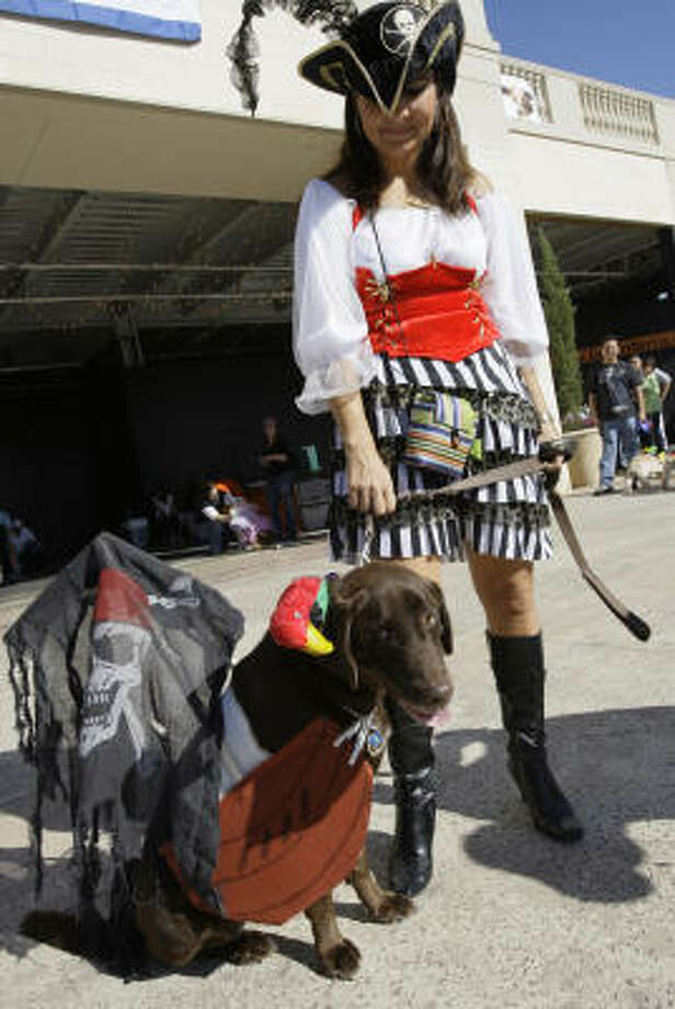 Pirate Patty Gomez and Angel, a chocolate lab dressed as a pirate ship, won first place at Citizens for Animal Protection's Howl-o-ween dog costume contest. Photo: Melissa Phillip, Chronicle