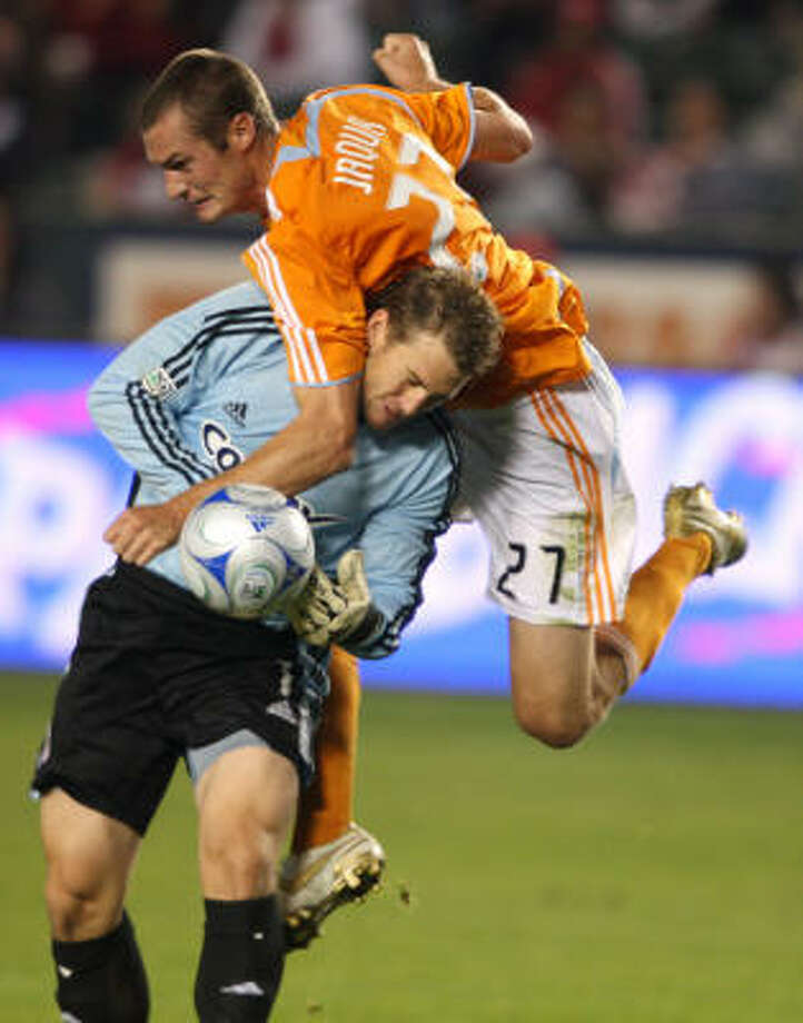 Chivas USA goalie Dan Kennedy collides with Houston Dynamo's Nate Jaqua (27) as they go for the ball during the first half of an MLS soccer match. Photo: Jeff Lewis, AP