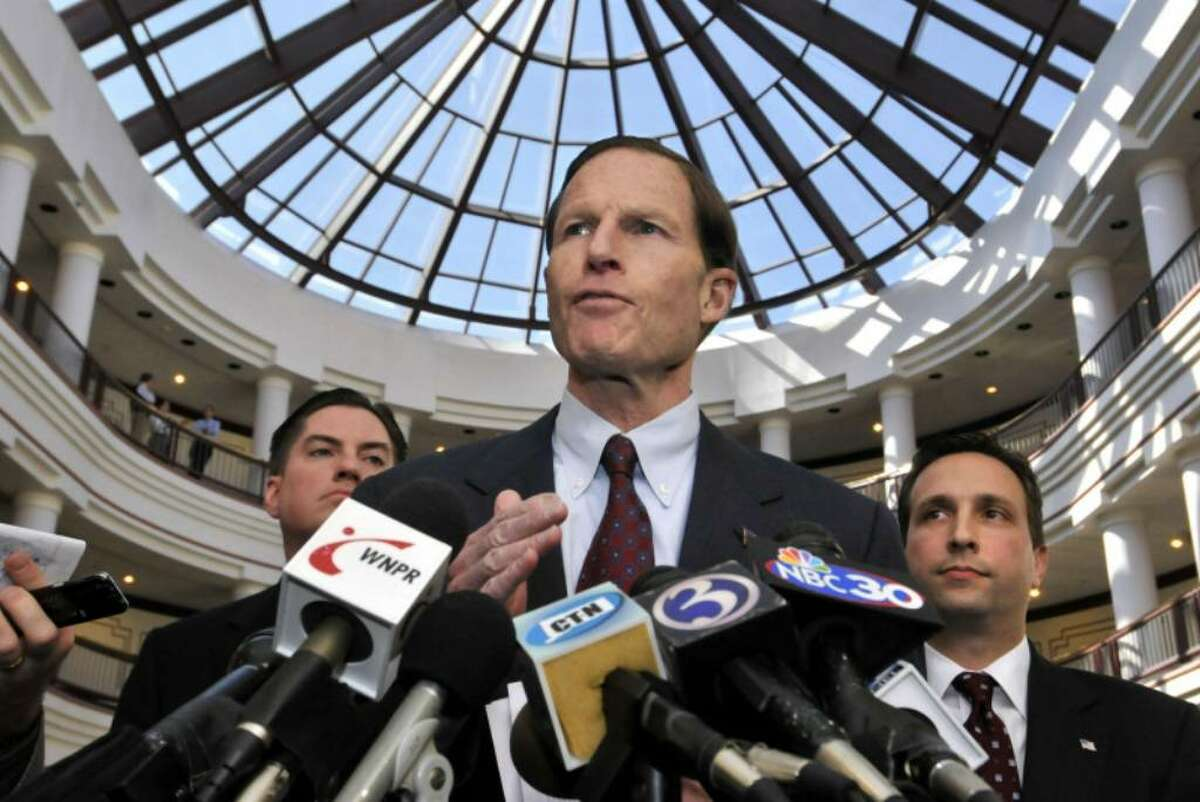 Connecticut Attorney General Richard Blumenthal, center, state Sen. Bob Duff, D-Norwalk, right, and state Rep. Ryan Barry, D-Manchester, left, discuss their talks with American International Group Inc. regarding legislative subpoenas to former and current AIG employees during a news conference at the Legislative Office Building in Hartford, Conn., Tuesday, March 24, 2009. (AP Photo/Jessica Hill)