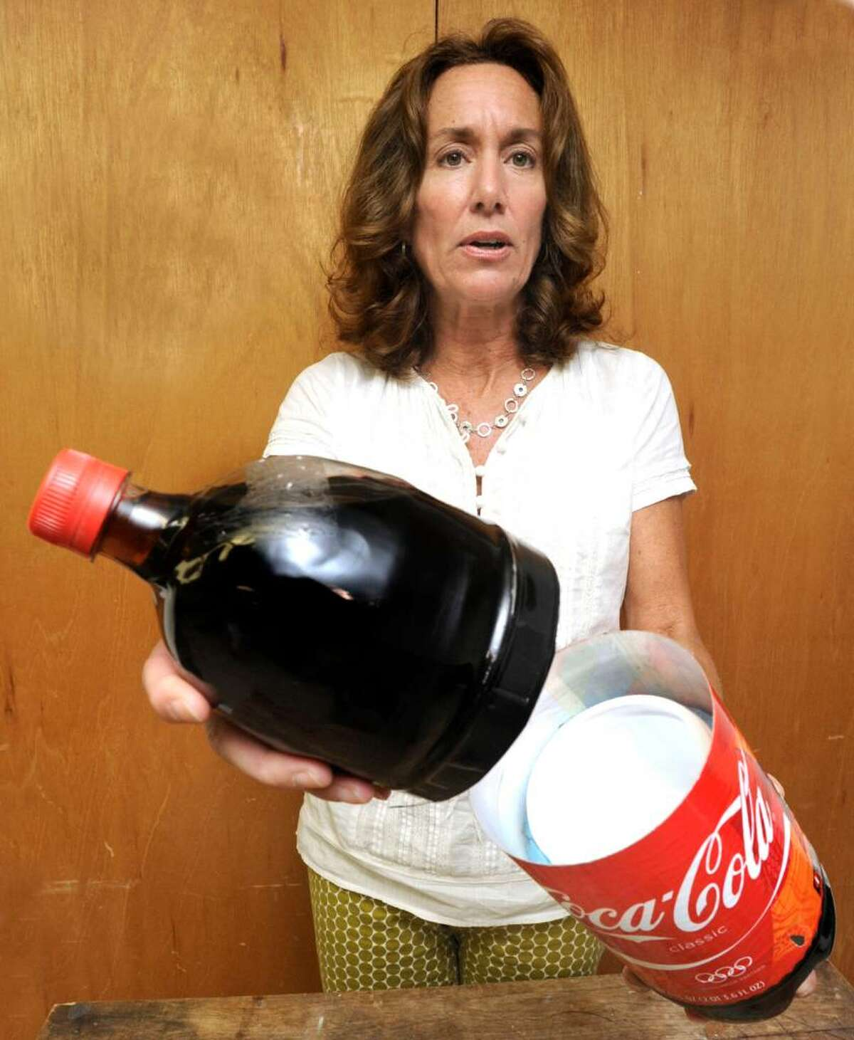 Allison Fulton, excutive director of Housatanic Coalition Against Substances, demonstrates a Coke bottle used to hide stash, and can be purchased in the mall, on friday.