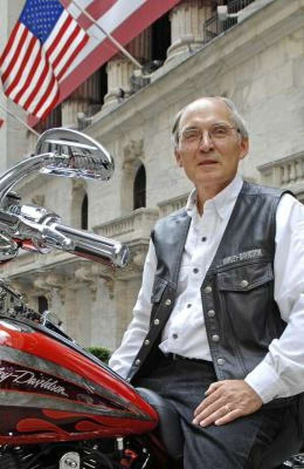 Jim Ziemer, CEO of Harley Davidson, shows off a bike earlier this summer in front of the New York Stock Exchange. Photo: LOUIS LANZANO, ASSOCIATED PRESS FILE