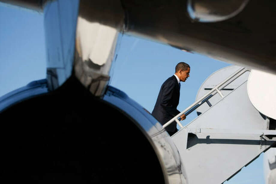 Sunday, Oct. 26: Democratic presidential nominee U.S. Sen. Barack Obama walks up the ramp to his plane at Albuquerque International Sunport airport in Albuquerque, New Mexico. Photo: Joe Raedle, Getty Images