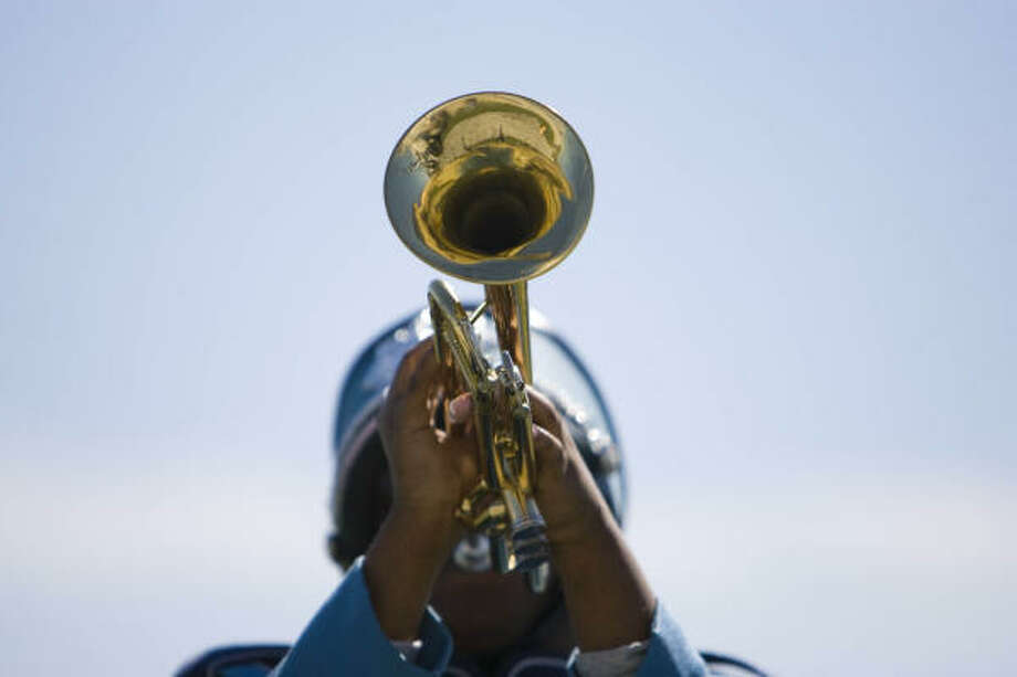 A trumpeter from the Sterling High School marching band plays during the HISD 2008 High School Marching Band Extravaganza Saturday at James M. Delmar Stadium in Houston. Photo: Nick De La Torre, CHRONICLE