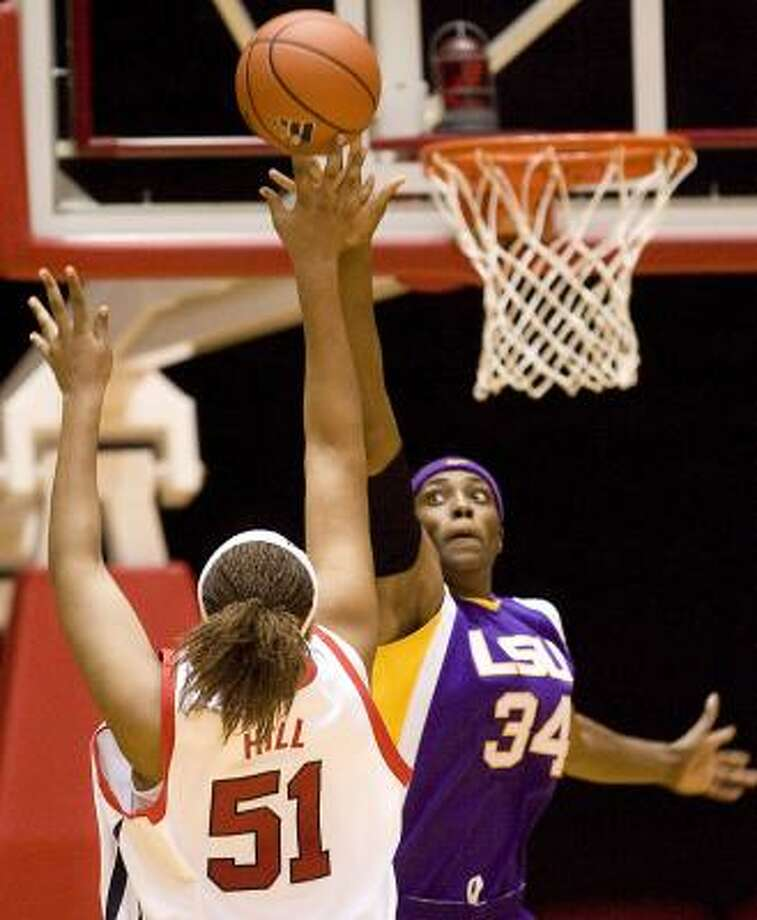 UH's Cobilyn Hill has her shot blocked by LSU center Sylvia Fowles, who also added 19 points. Photo: BOB LEVEY, ASSOCIATED PRESS