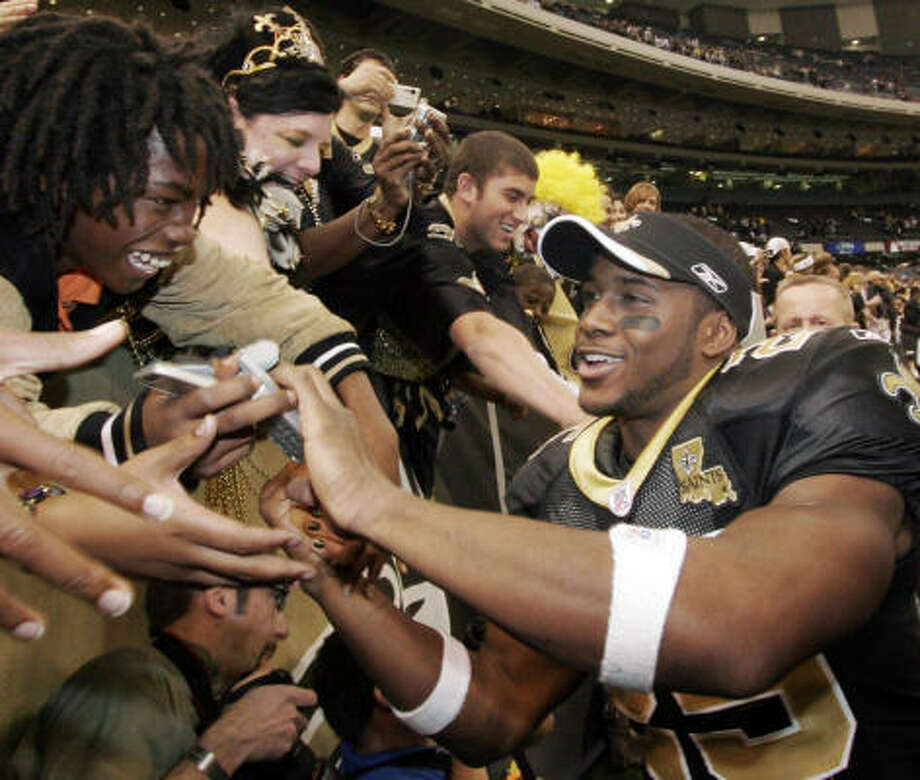 Reggie Bush may have been No. 2 in the NFL Draft, but the Saints have become No. 1 with many fans and have helped give New Orleans something to get behind in the wake of Hurricane Katrina. Photo: Alex Brandon, AP