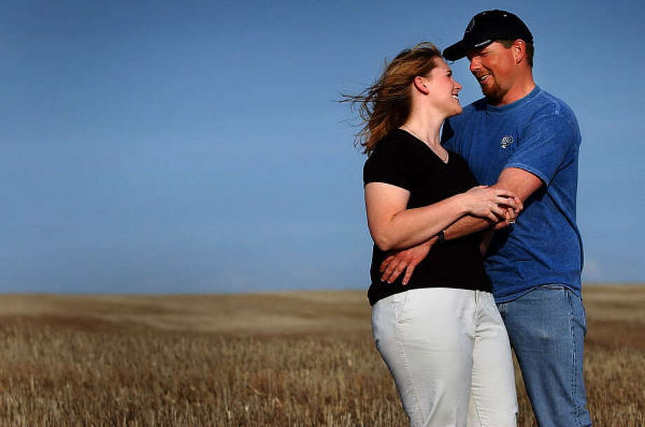 When2003. Lucky couple: Kristin Alme and Kyle Zellmer.  What's going on here?: He wrote out his proposal in a wheat field in Davenport, Wash., and hired a plane to fly them over it ... Photo: BRIAN PLONKA, AP