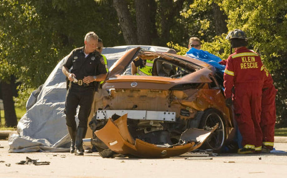 The two students, identified as Zachary Larwa, a senior, and Phi Le, a junior, were in a gold Nissan 350Z. They struck a Honda Civic driven by a woman identified as Anna Karpenia. Photo: Steve Campbell, Chronicle