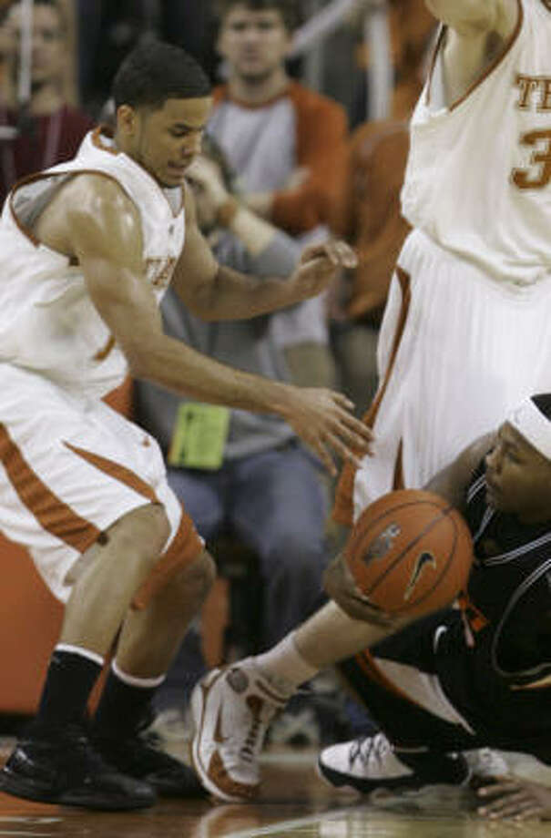 Kevin Durant is Texas's star, but D.J. Augustin, left, makes the Longhorns go. Photo: LM Otero, AP