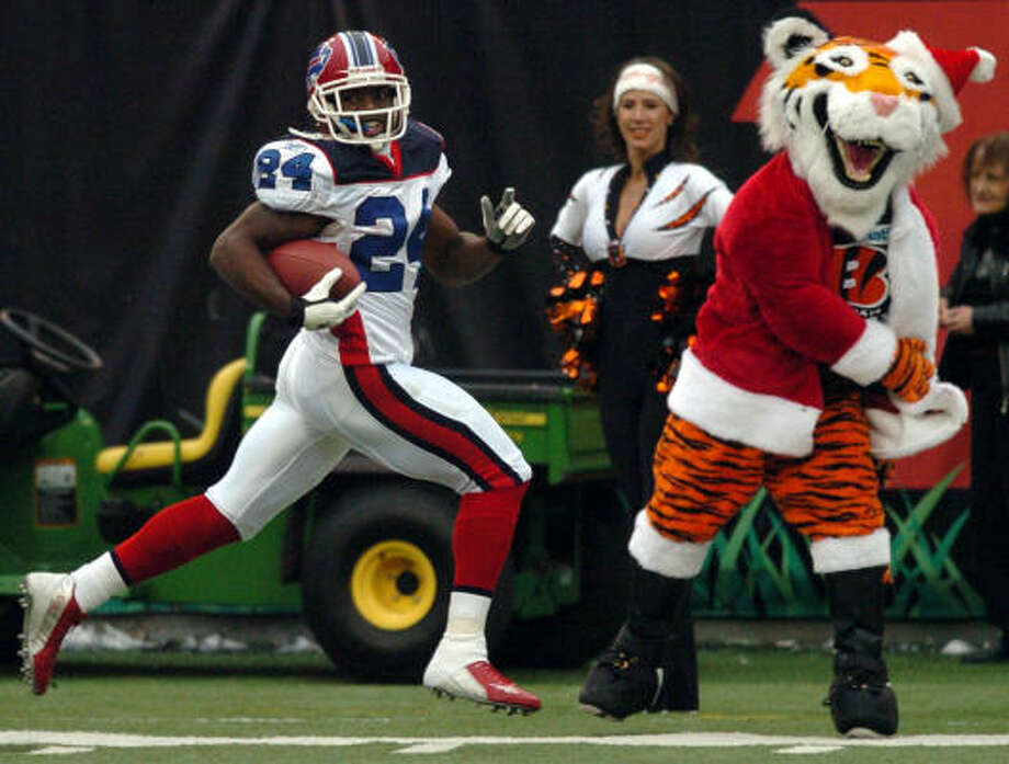 Buffalo Bills' cornerback Terrence McGee gets an early Christmas present, running for a 99-yard touchdown on a kickoff return against the Cincinnati Bengals last Christmas eve. Photo: TONY TRIBBLE, AP