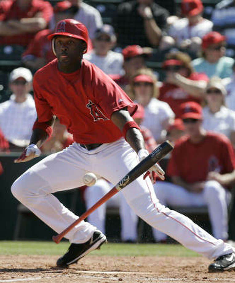 Gary Matthews Jr., of the Angels bunts against the Oakland Athletics then sets sail for first base in spring action earlier this month. Photo: Chris Carlson, AP