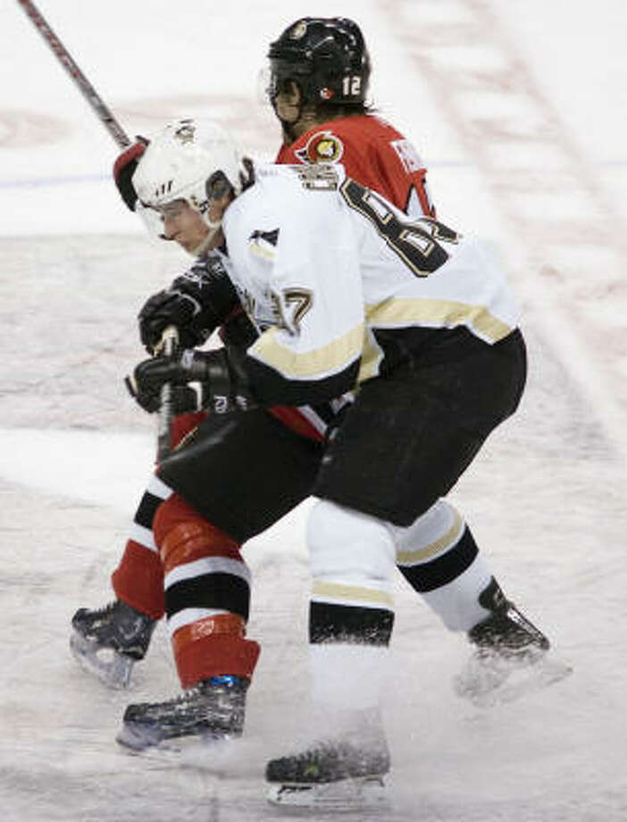 Sidney Crosby (in white) has scored in shootouts in three of his last four games. Photo: Jonathan Hayward, AP