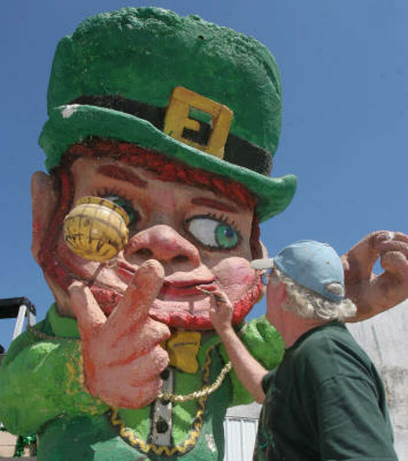 Gary Holman spruces up a leprechaun for the Grand Marshal's float in today's St. Patrick's Day parade. Photo: Gary Fountain, For The Chronicle
