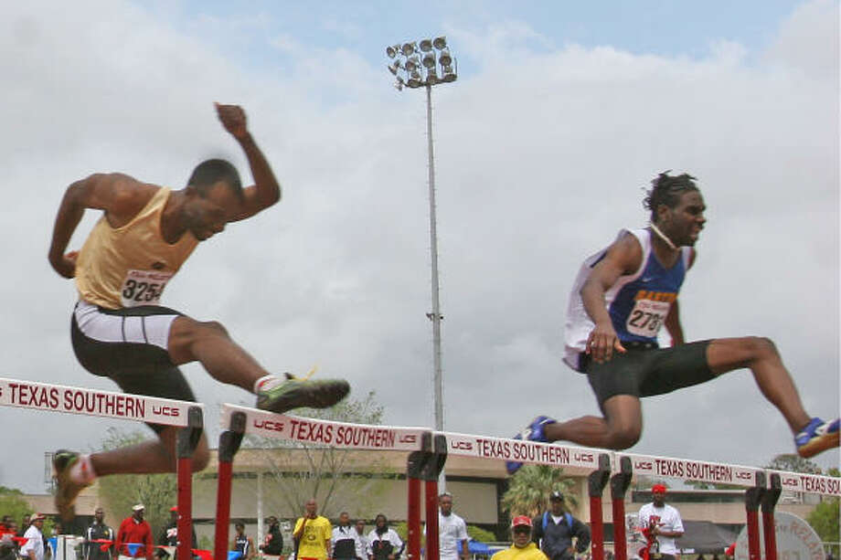 Barton County (Kan.) Community College's Darryl Elston, right, edges Grambling's Edmund Graham in the Section 1 finals of the men's 400-meter hurdles Saturday at the Texas Southern Relays. Photo: MARGARET BOWLES, FOR THE CHRONICLE