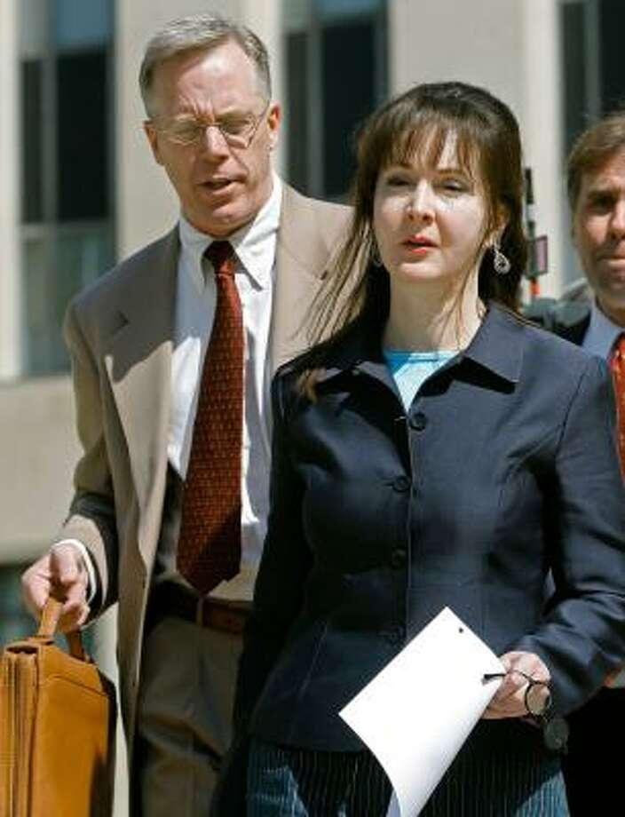 Montgomery Blair Sibley accompanies Deborah Jeane Palfrey after a court hearing in Washington last week. Photo: MARK WILSON, GETTY IMAGES