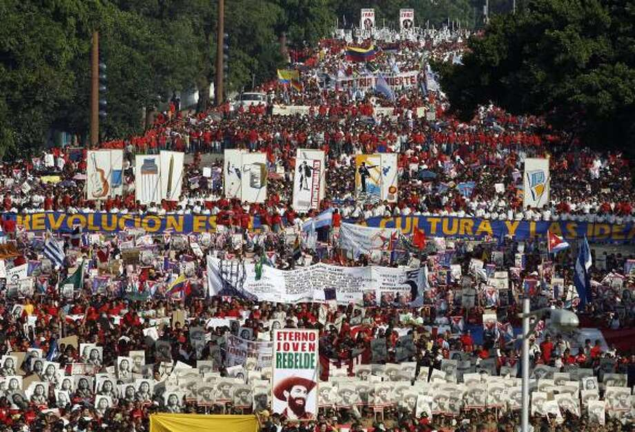 A parade marking International Workers' Day draws hundreds of thousands to Revolution Plaza in Havana. Tuesday was only the third time in 50 years that Cuban President Fidel Castro has missed the event. Photo: JAVIER GALEANO, AFP/GETTY IMAGES