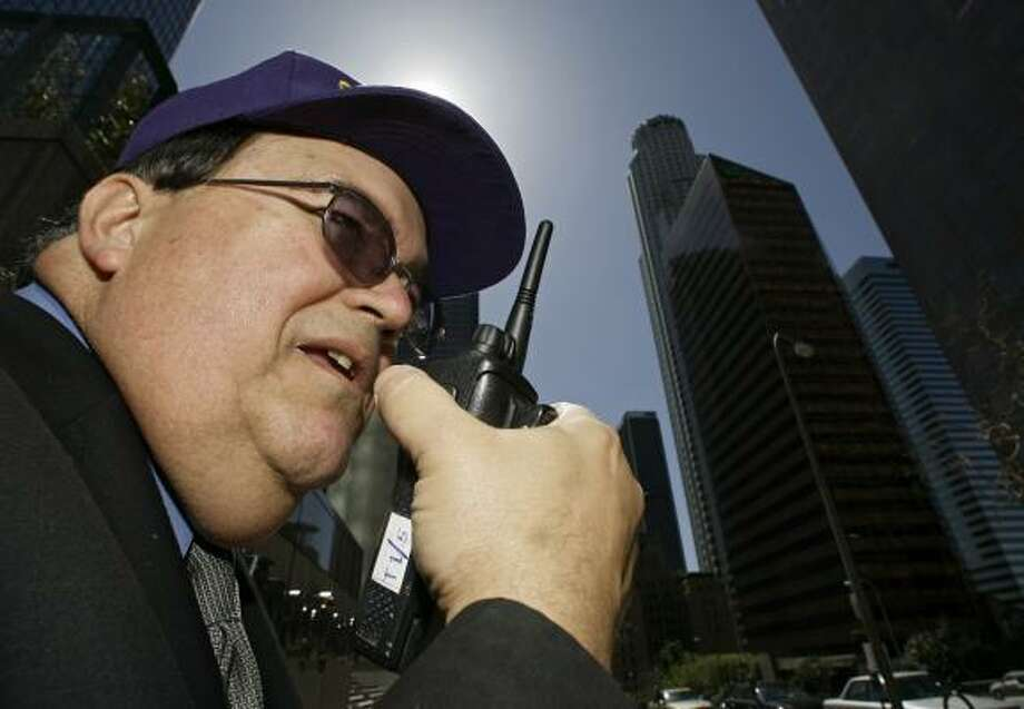"Private security guard Richard Bergendahl protects a high-rise building near the 73-story landmark U.S. Bank Tower in Los Angeles. The security guard industry was transformed after 9/11 from an army of ""rent-a-cops"" to protectors of the homeland. Photo: Damian Dovarganes, AP"