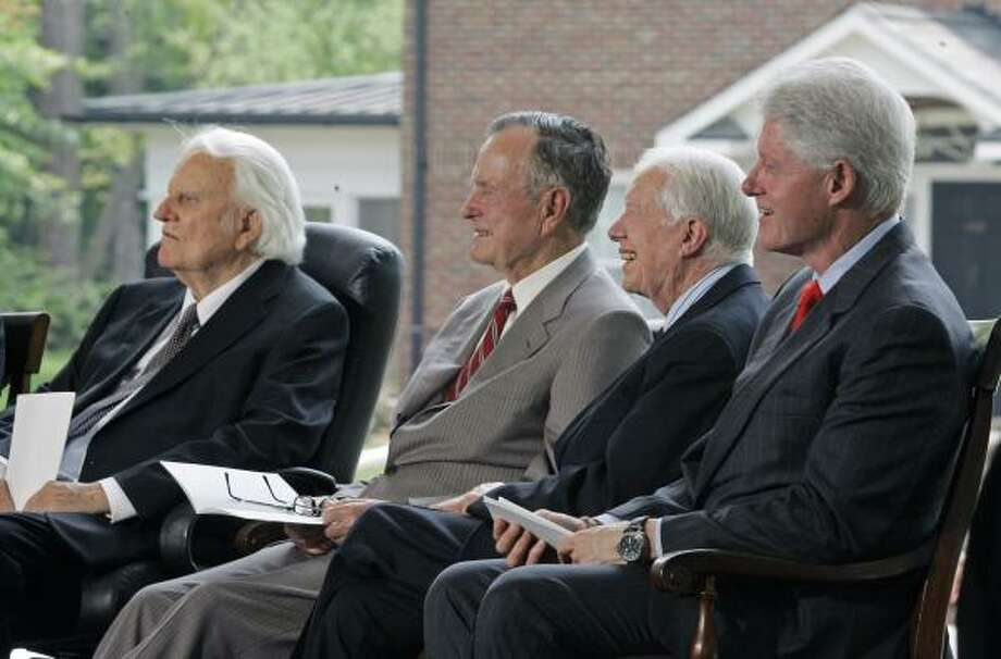 Former Presidents George H.W. Bush, Jimmy Carter and Bill Clinton joined the emotional dedication of a $27 million library honoring Billy Graham, left, on Thursday. Photo: Chuck Burton, AP