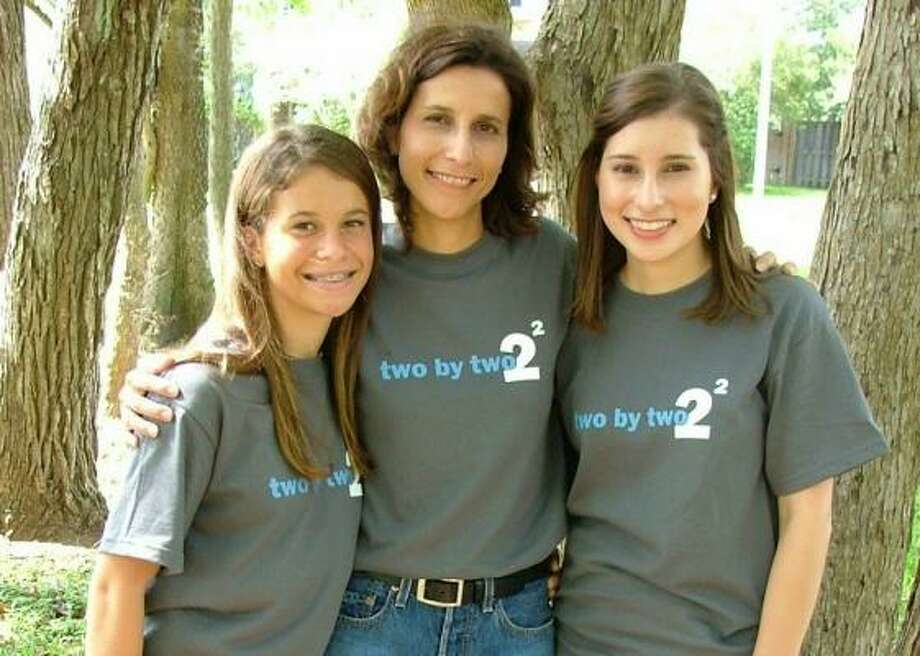Kristin Murray, right, her sister Emily and mother,  Mary, come from a family affected by sarcoma. Photo: Cancer Foundation