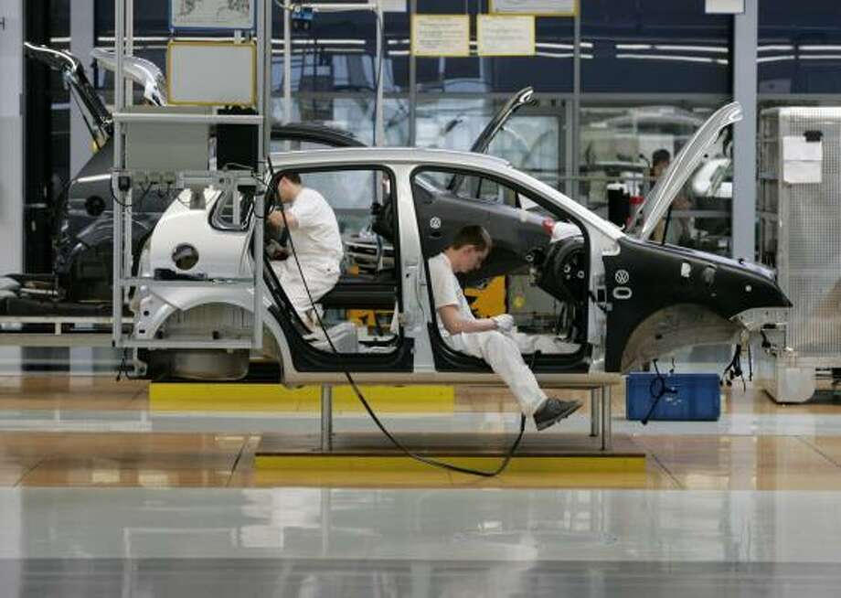Workers assemble a Volkswagen Polo car at the company's factory in Bratislava, Slovakia. Auto production is playing a key role in the economic revival of Eastern Europe. Photo: JOCHEN ECKEL PHOTOS, BLOOMBERG NEWS