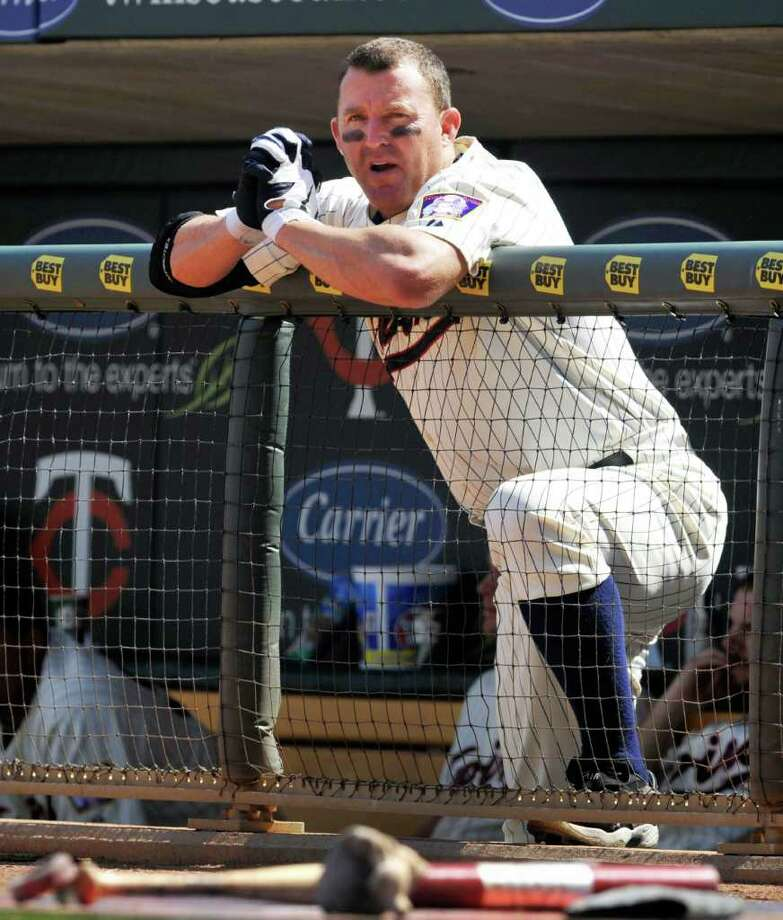 FILE - In this Aug. 7, 2011 file photo, Minnesota Twins' Jim Thome watches from the dugout as the Chicago White Sox bat during the eighth inning of a baseball game in Minneapolis. Thome is two home runs shy of 600 for his career. (AP Photo/Tom Olmscheid, File) Photo: Tom Olmscheid, FRE / AP