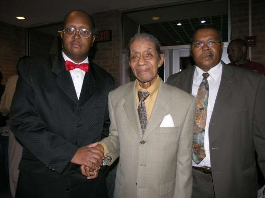 Conrad O. ``Prof'' Johnson, 91, center, with former Kashmere High School student Anthony Jackson, left, and Johnson's son, Conrad Johnson Jr., right, founded the Kashmere High stage band. Photo:  Fannie Williams, For The Chronicle