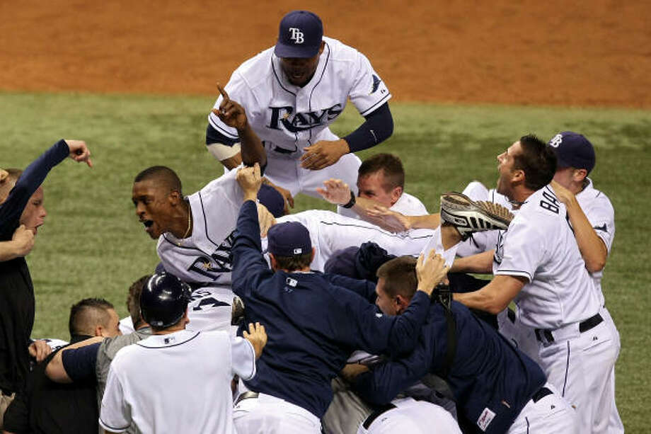 After the Tampa Bay Rays beat the Boston Red Sox in the 2008 ALCS they are on their way to the World Series.  Will the Rays be the next team to go from worst to first? Photo: Doug Benc, Getty Images