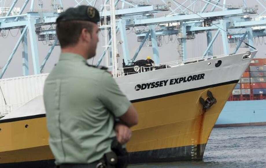 The Odyssey Explorer is guarded in Algeciras, Spain. A U.S. judge urged attorneys to work out a deal allowing the salvage company to disclose information about treasure it recovered to Spanish officials. Photo: A. CARRASCO RAGEL, EFE FILE